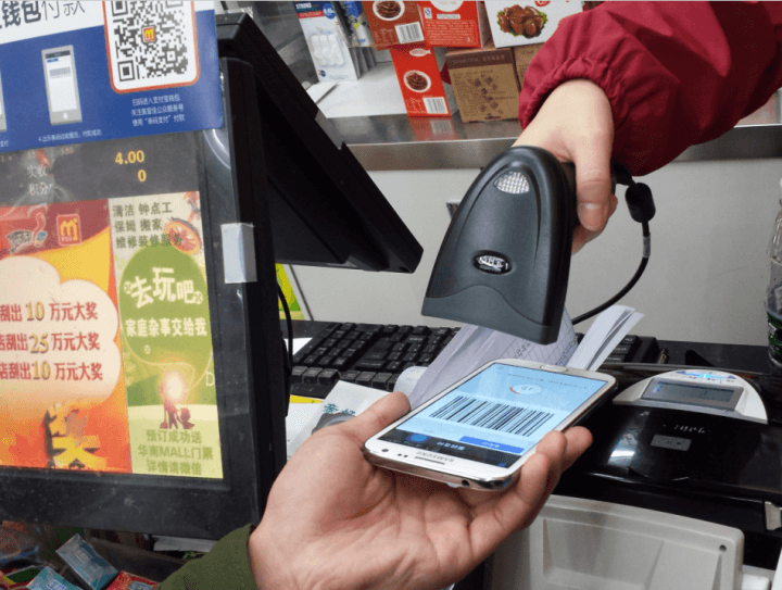 Betalning med Alipay i butikens kassa